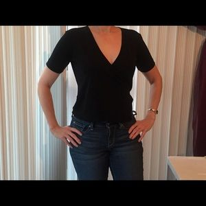 A cute Black Wrap top. Great with Jeans/skirt.